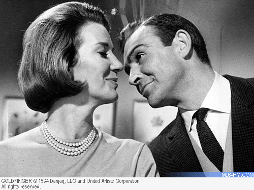Lois Maxwell as Miss Moneypenny with Sean Connery as James Bond in Goldfinger