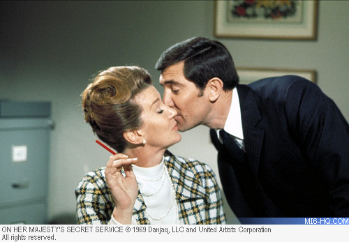 Lois Maxwell as Miss Moneypenny with George Lazenby as James Bond in OHMSS
