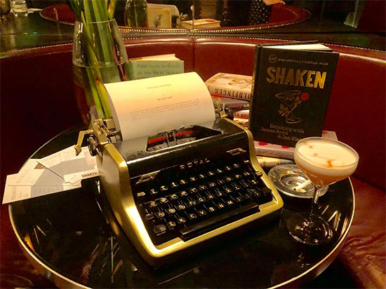 Fleming typewriter, cocktail and Shaken book